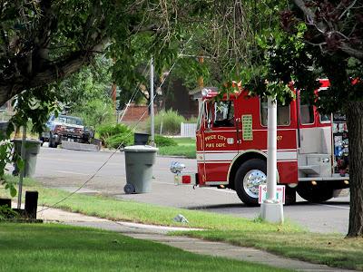Fire truck blocking the road near the fallen power line