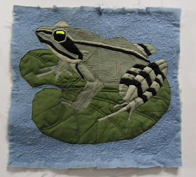 Frog on a lilly pond leaf. Machine pieced and quilting. Pieced are extremely small