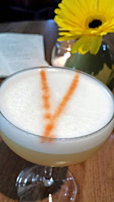 Raven & Rose special drink for May 2014, the Paper Crane. It's made with New Deal Hot Monkey pepper vodka, Benedictine, peach cordial, lemon juice, honey, egg white, and Angostura bitters to present a well balanced mix of spicy and sweet and sour and lightness.