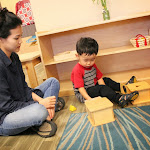 Toddlers work with compelling Montessori materials at the Parent & Child classes.