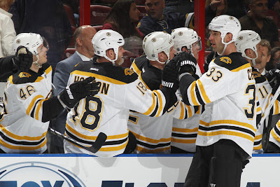 Zdeno Chara celebrates his goal with his teammates