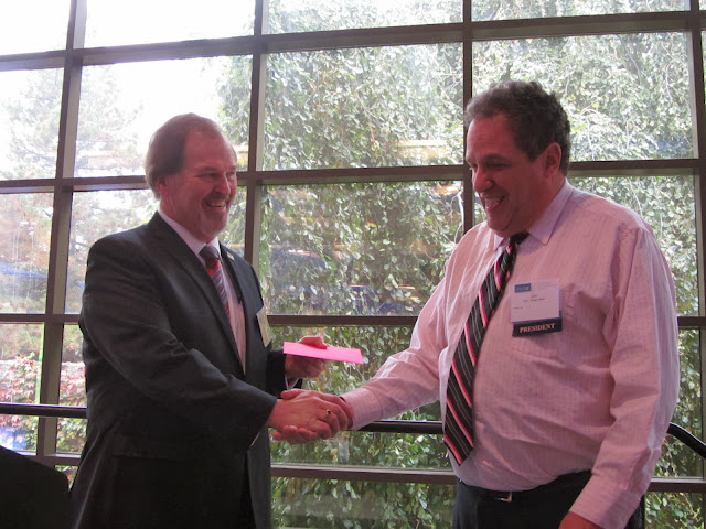 Joseph Vincent, Chair-Elect, 2013-2014 Institute of Management Accountants shows his appreciation to John Engel, President of the IMA Michigan Council