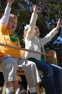 Kids perched on the Mardi Gras ladder