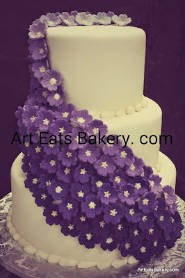 Cascading edible purple flowers creative modern wedding cake design