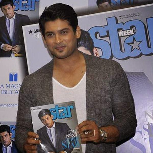 Siddharth Shukla unveils the latest issue of Star Week magazine in Mumbai, on July 31, 2014.(Pic: Viral Bhayani)