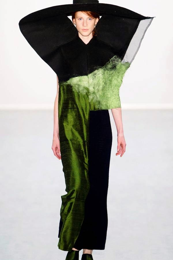 A model presents a creation designed by fashion students of the University of Arts (Universitaet der Kuenste) at the Berlin Fashion Week 2014 in Berlin July 10, 2014.