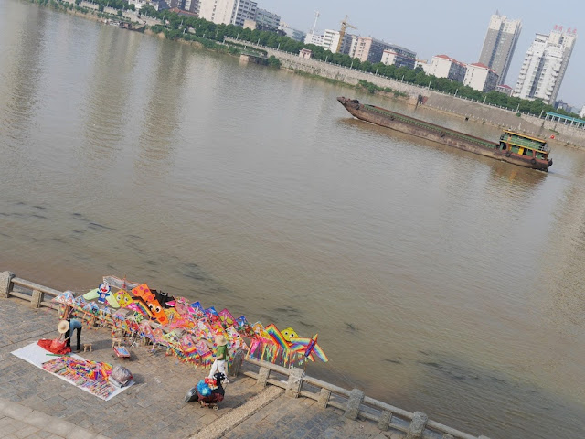 kites for sale next to the Xiang River in Hengyang