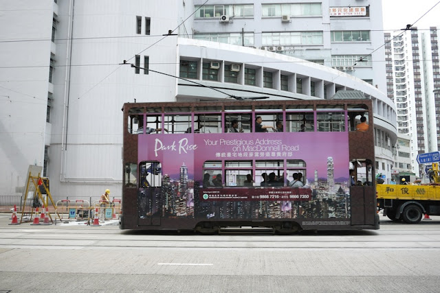 Tram in Hong Kong with Park Rise apartments advertising