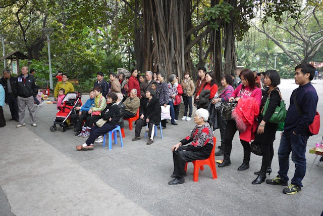 crowd watching performance of Chinese opera in Guangzhou