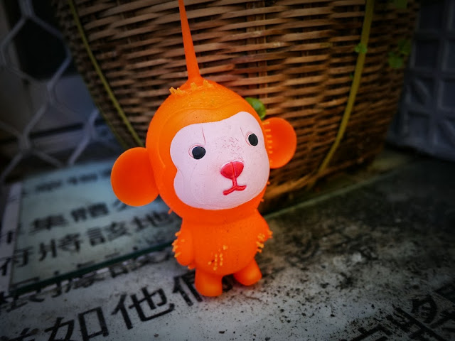 hanging orange toy monkey in Cheung Chau