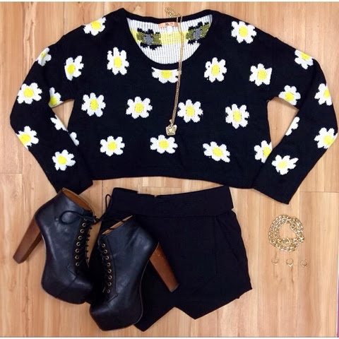White and yellow flowered sweater, black skirt and black high heel boots