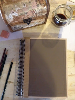 Recycled cover of my my sketchbook. And, yes, that is coffee I'm using to paint with.