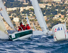 J/24 sailboat- sailing to race mark at Monaco Primo Cup