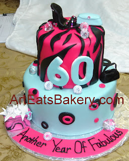 Two tier hot pink, Tiffany blue and black fondant diva 60th birthday cake with zebra, dots, diamonds, shopping bag, shoe and handbags