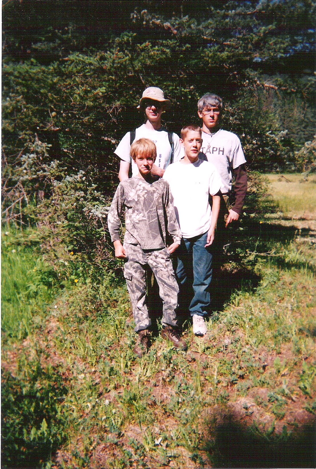 a picture of me with three campers in the woods.