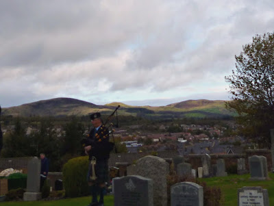 piper at the graveside