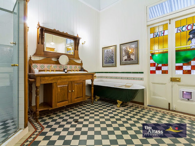 A Victorian style bathroom, with clawfoot bath and black and white tiling, very typical Victorian era style
