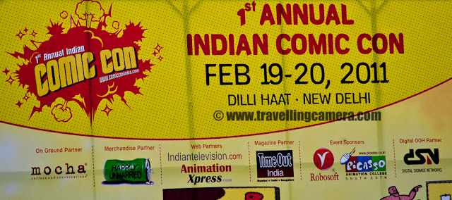 First Annual Indian Comic Con at DILLI HAAT, New Delhi : Feb 19-20, 2011 : Posted by VJ SHARMA on www.travellingcamera.com : Comic con has been a grand event for comic enthusiasts in various parts of United States of America and now a new event in India has increased the count of total comic cons across the world !!! This Year, India hosted first Comic Con at Dilli Haat, New Delhi !!! There are huge enthusiasm among Indians.. be it children, youngsters or senior folks.. Check out these Photographs to have a virtual tour of Indian Comic Con on second day (20th Feb, 2011) !!!Main poster of First Indian Comic Con Event which happened in Delhi last month and it was used as background for main area where many events happened and folks from this industry presented some innovative stuff or talks !!Another poster of First Annual Indian Comic Con at Dilli Haat !!! As this hoarding is saying, there were lot of prizes for folks who came there in various dress-ups to look like any comic Character.. Comic characters like Chacha Chowdhary, Wolverine, Lord Krishna, Spiderman,Zombie, Kalki, Crime Master Gogo, Batman, Harley Quinn etc... These were few comic Charcters which I saw during second day and rain spoiled i during the evening :( .... But never mind, it was good to see this kind of event in India and it would be great if they can organize it in various cities of India because there are lot of comic fans spread over the country !!!Here comes Mr. Chaitanya Vats who was one of the popular person in Indian Comic Con.. He is acting as Wolverine !!! and everybody wanted to have a photograph with him !!! Good work Dude !Vikas looks tired but its sadness because of rains.. It rained around 4:00 pm and the event was in open area.. So everyone dispersed and went under various stalls installed by different comic publishers... Vikas and Anu had great time at Comic Con and enjoyed nice snacks in Dilli Haat !!! but surprisingly no shopping :) (I mean very less shopping) Here comes Mr. Andy Dodd as Chacha chowdhary which was most famous comic character of my times.. In my childhood m friends used to read lot of his comics and the other one was Nagraj I guess :) Most of them used to buy these comics, read them in classroom and exchange with each other...Lord Krishna giving interview to some TV channel and zombie came to disturb him.. And Lord Krishna trying to request for SHANTI and zombie didn't know who is SHANTI & where to find her !!! Finally Lord Krishna was able to negotiate with Zombie both of them were talking to media folks about First Indian Comic  Con in delhi & overall experience of this event !!!How come Zombie is calmly replying to Krikhna's questions? The commendable thing about both of these folks was the effort they had put to get prepared for Comic Con.. Make-up done by Zombie was unique and it must have taken lot of time to get ready for final day of the event !!!Many of the youngsters were really fan of zombie.. He was the one who was doing real acting.. be is walking, talking or giving weird expressions :) Children were really scared of him .. They liked him but didn't want to go closer to him to get a photograph.. Yes, getting clicked with these characters was most popular activity of this whole event.. I think many of the visitors were more interested in getting a photographs rather than anything else...There were lot of cute babies roaming around with colorful dress-ups.. This shy boy was here as Spiderman :)Kalki - That's the name of this character and I was wondering how can he stand like this in winters and rains must have made it more difficult for him.. Great work dude !!!He was just standing inside a comic stall and not that involved with the visitors of Indian Comic Con event.. Other characters were just roaming around the place to entertain folks by their expressions or by other means Batman and Harley Quinn : Rajat and Monika !!! Monika was the only girl I saw on second day... Actually I was at wrong time of the day when rain was about to start .. I had seen few more girls but couldn't catch them.. This group of Batman, Harley Quinn, Crie Master Gogo and Wolverine was most energetic group out there.. I am not sure who won the prize but for me this group rocked the show !!!Again the same group giving different expressions !!! Great show Guys !Rocking group of folks as various characters if Comic Con India at Dilli Haat !!!TRP Stunts :) which are very important these days !!!Harley Quinn looking at the digicam ... I liked her shoes btw :)Here comes our little Comic characters and visitor getting photographs with these celebrities of the day !!!Lord Krishna also got a Bansuri and silently playing it !!!Anu didn't want any pic but Vikas managed to convince her for the first try .. and now on it was easy :)Thanks for the nice pose :)