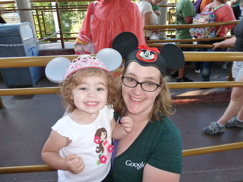 Phoenix and Jenn with mouse ears.