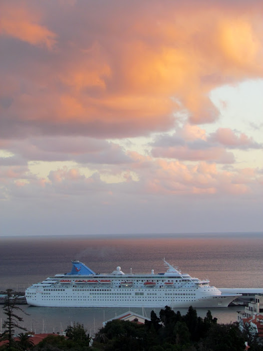 orange clouds over the cruise ship