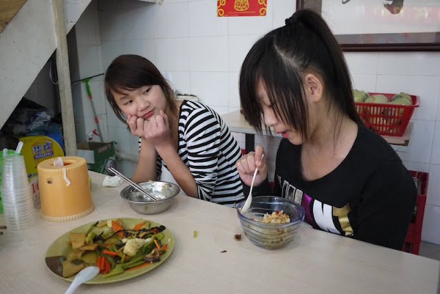 two girls talking to each other at lunch in Zhuhai, China