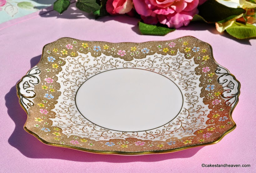 Tuscan pink fine china cake plate decorated with gold