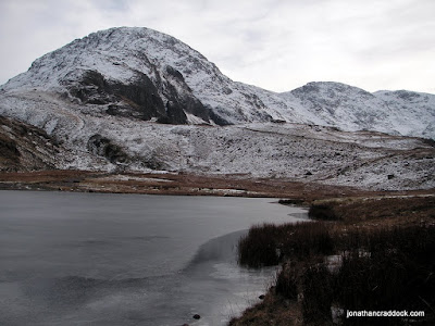 Great End seen across a part frozen Styhead Tarn.