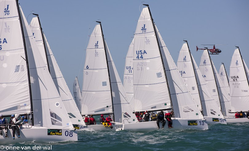 J/70 one-design fleet- sailing off starting line