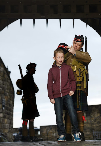 Callum Hand, aged 10, meets re-enactors playing soldiers from the 1914 Gordon Highlanders regiment ahead of Edinburgh Castle's World War One event, taking place at the castle, on Saturday 18th and Sunday 19th October.