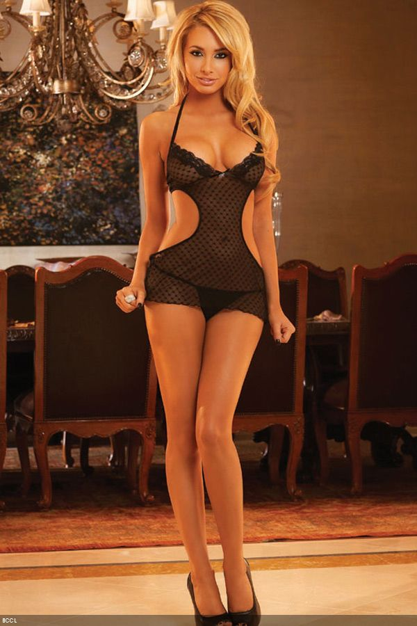 A model sports a pair of black sheer nightwear during the photoshoot.<br /> www.lalingerieindia.in