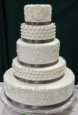 5 tier round white fondant custom wedding cake with edible pearls , elegant,  royal icing lace , rose design , florets and gray ribbons