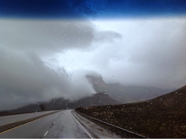 Photo of Guadalupe Peak nearly obscured in clouds and fog