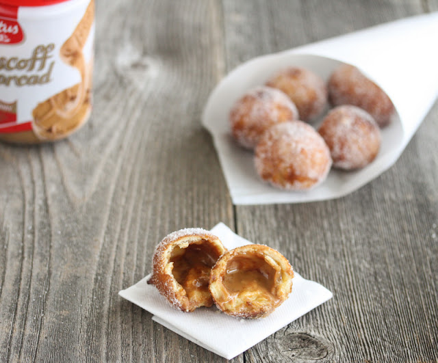 close-up photo of a donut hole cut in half to show the filling