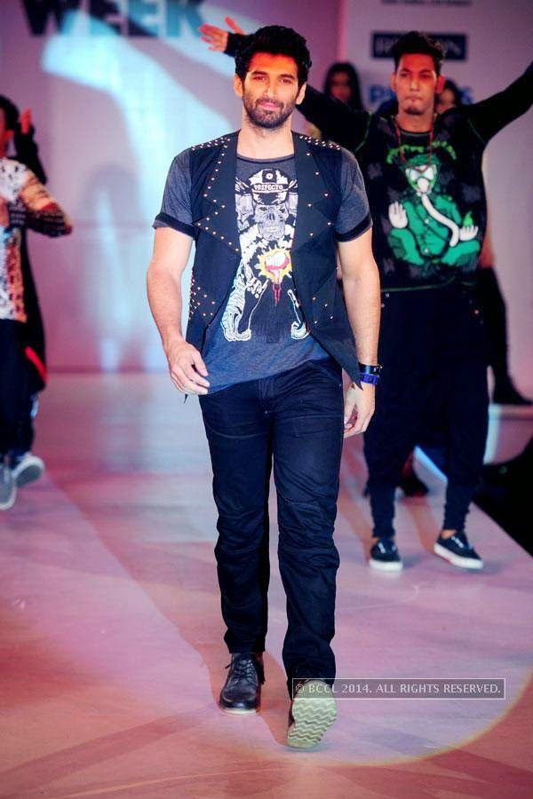 Aditya Roy Kapoor walks the ramp during Jabong Online Fashion Week, held at Hotel Le Meridian, in Delhi, on July 30, 2014.