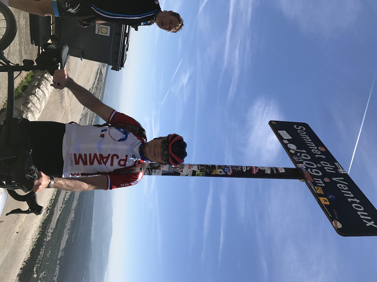 Bike Climb Mont Ventoux - John Johnson PJAMM Cycling with bike at summit sign