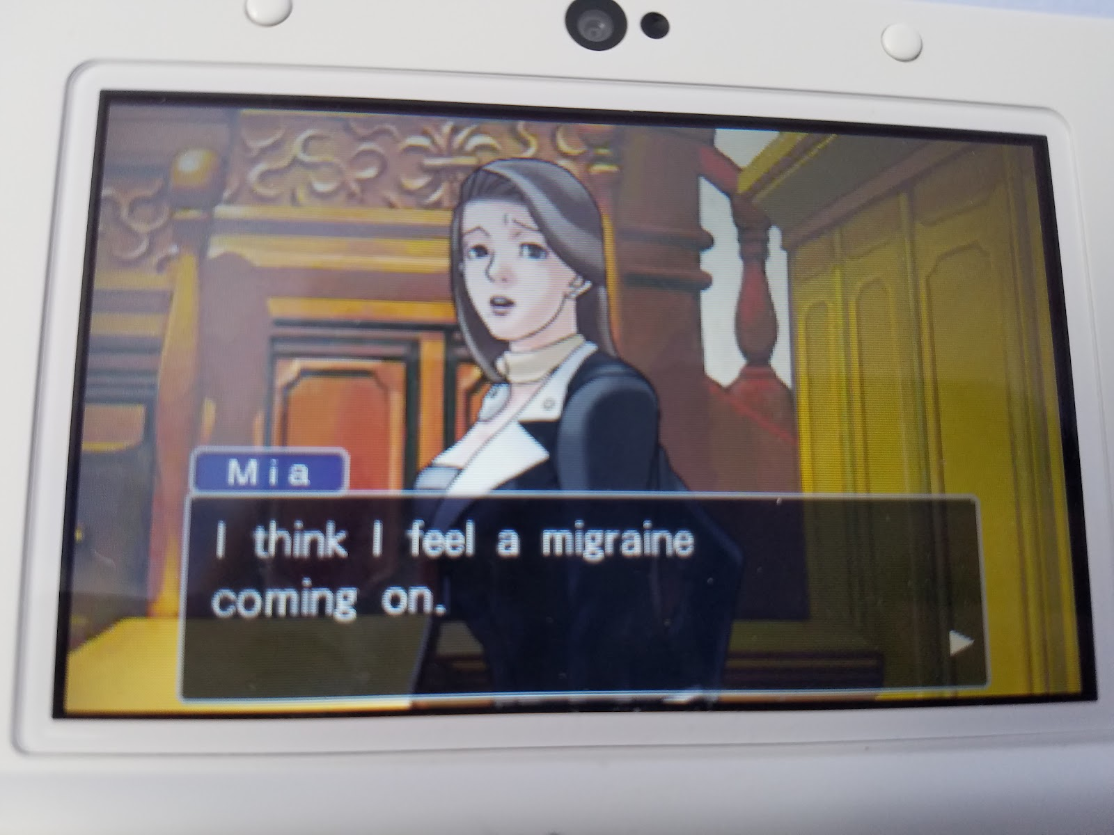 Phoenix Wright Ace Attorney Mia Fey feel a migraine headache