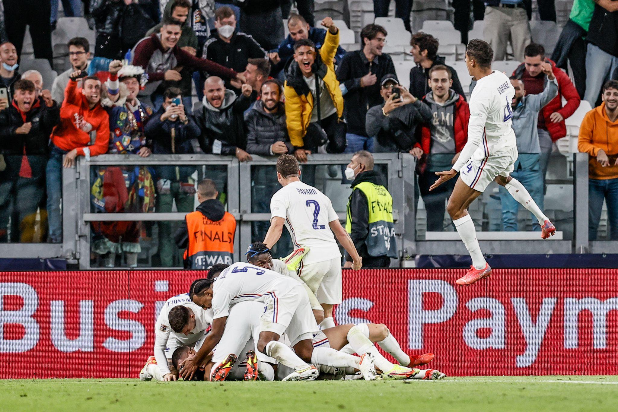 France players celebrate the last-minute winner against Belgium