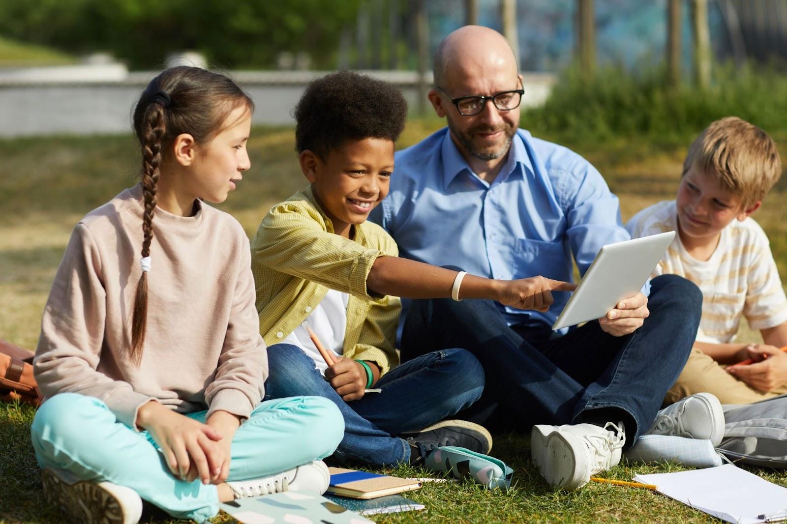 children-in-outdoor-class-with-teacher