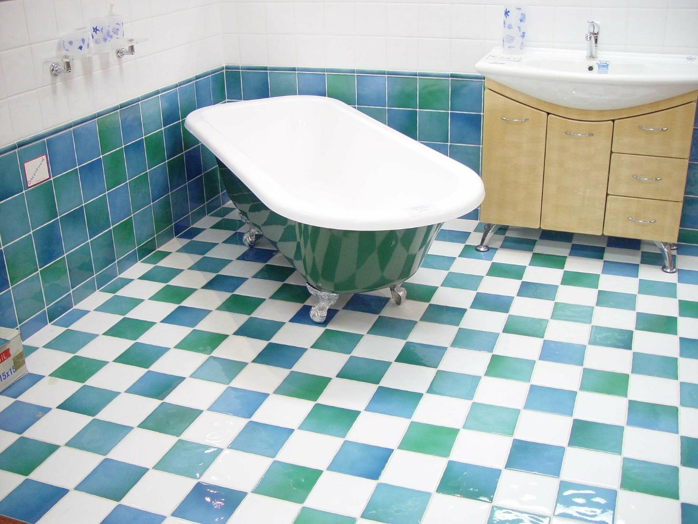 A bathroom with a tile floor  Description automatically generated