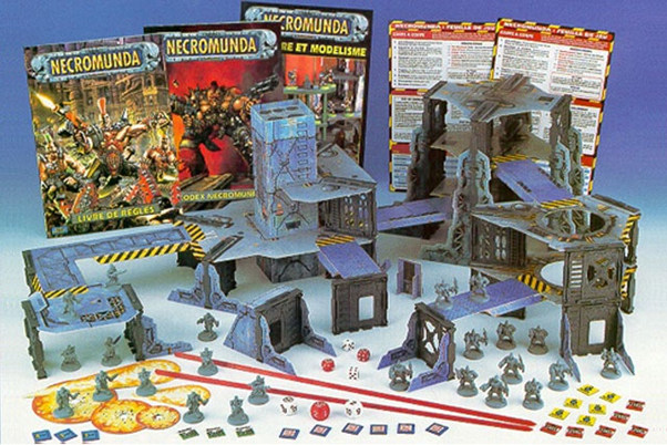 The original Necromunda boxed set - two opposing gangs, some 3-storey cardboard terrain, and a lot of brightly-coloured tokens and templates