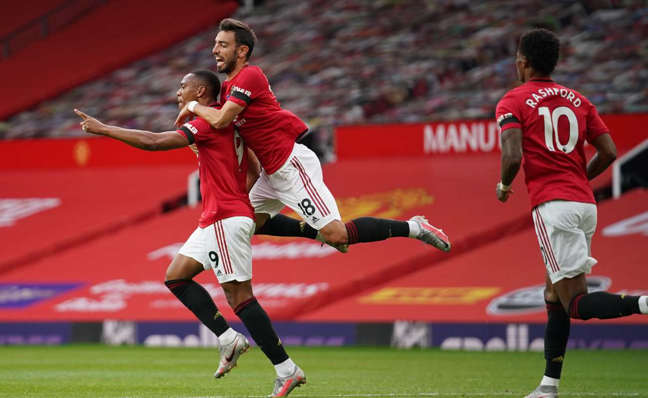Manchester United's Anthony Martial, Bruno Fernandes, and Marcus Rashford celebrate Martial's equalizer against Southampton.