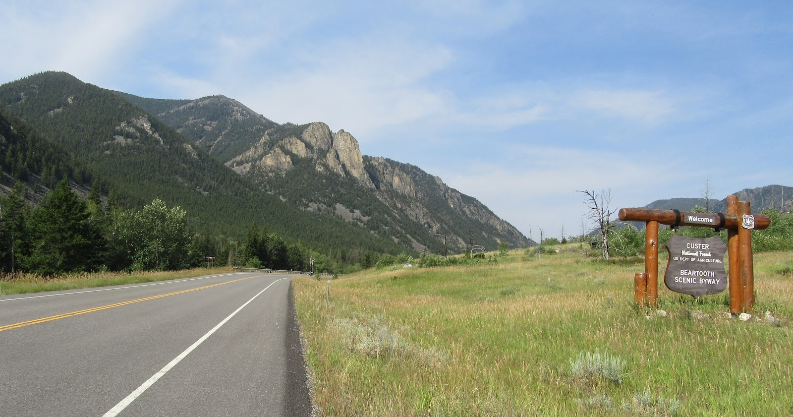 Bike climb up Bear Tooth Pass North - roadway and Custer Gallatin National Forest sign