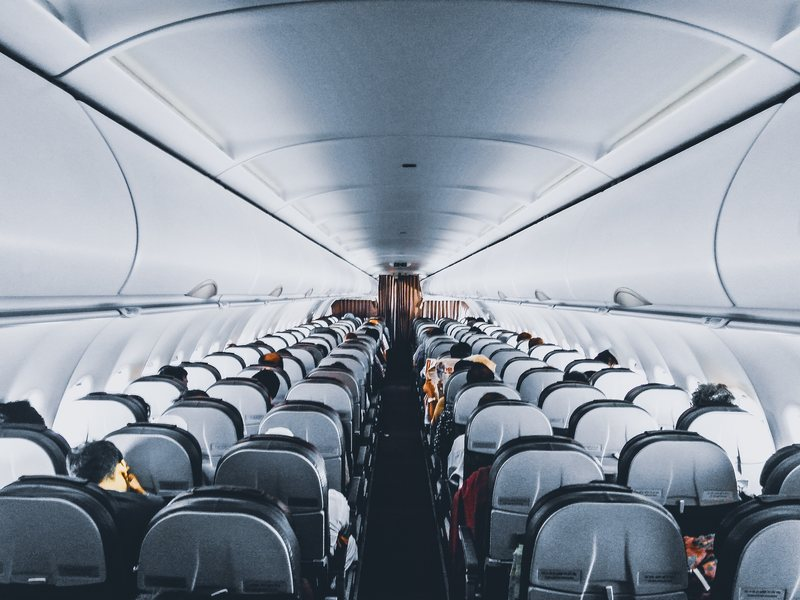 Interior of an Airplane with Lights On