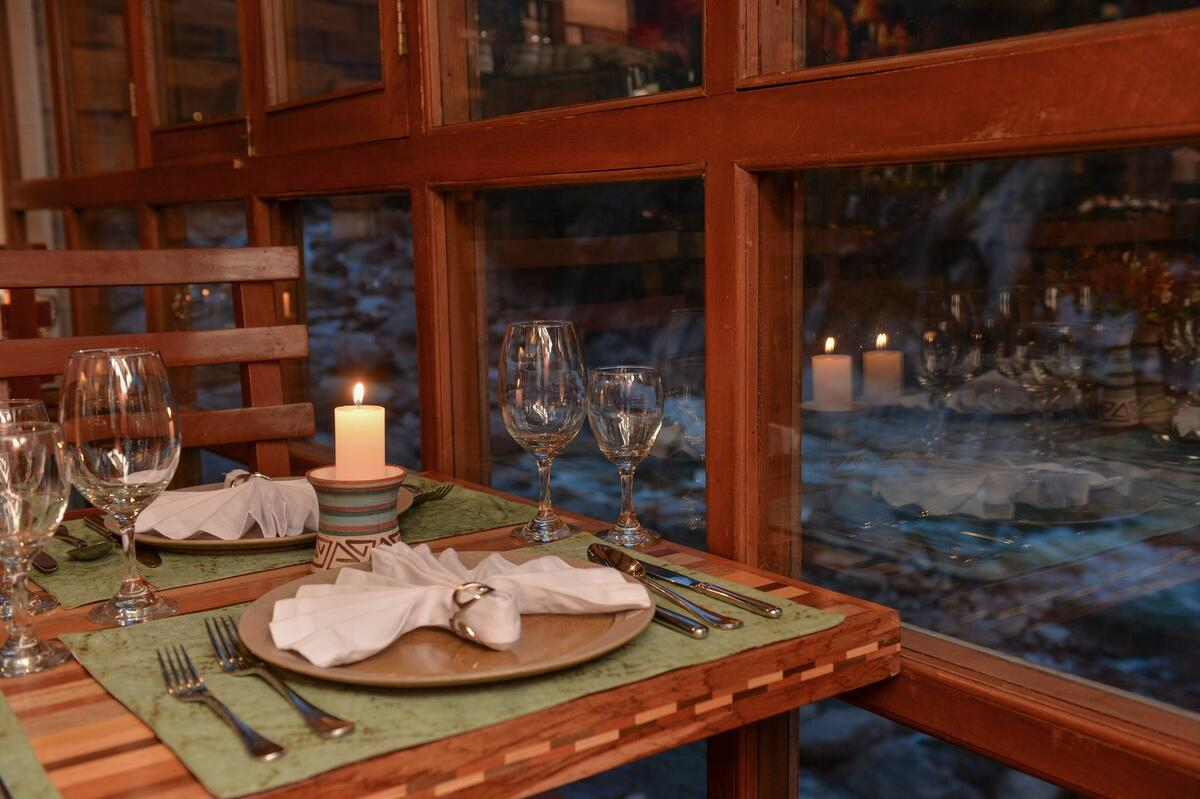 dining table with place settings with river view