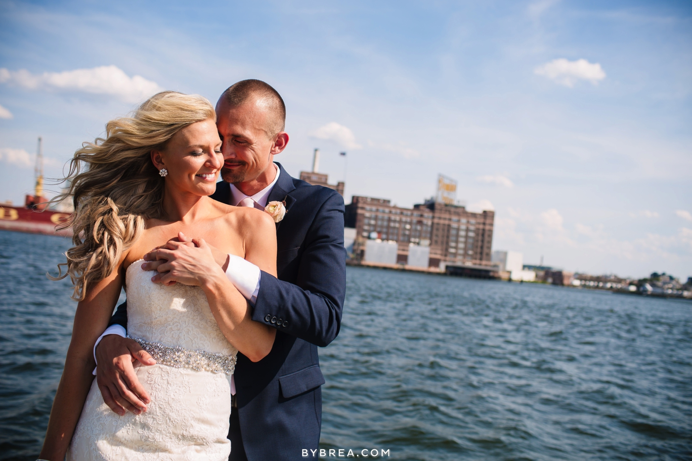 wedding couple by water and pier