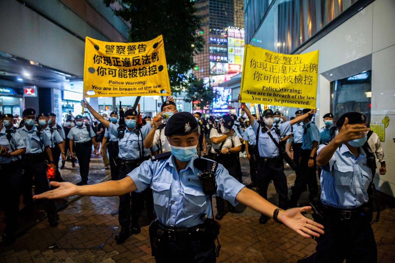 Police crowd control citizens as they gathered in the Causeway Bay district of Hong Kong on June 4, 2021, after the government closed a venue where Hong Kong people traditionally gather annually to mourn the victims of China's 1989 Tiananmen Square Massacre.