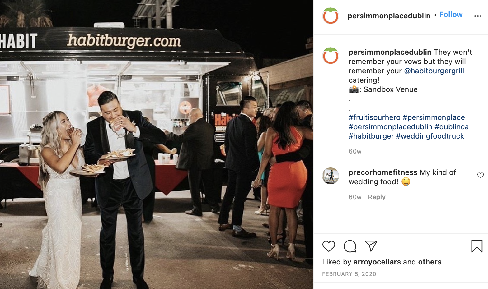 couple eating in front of their wedding food truck