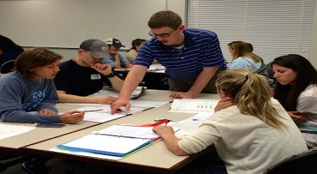 photo: instructor working with student group
