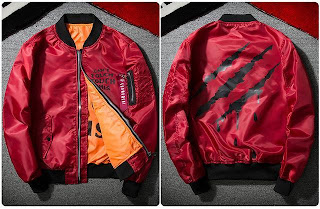 A red bomber jacket with a front design on chest saying 'CAN'T TOUCH TOUCH THIS' and claw-ripped-design on the back with black color