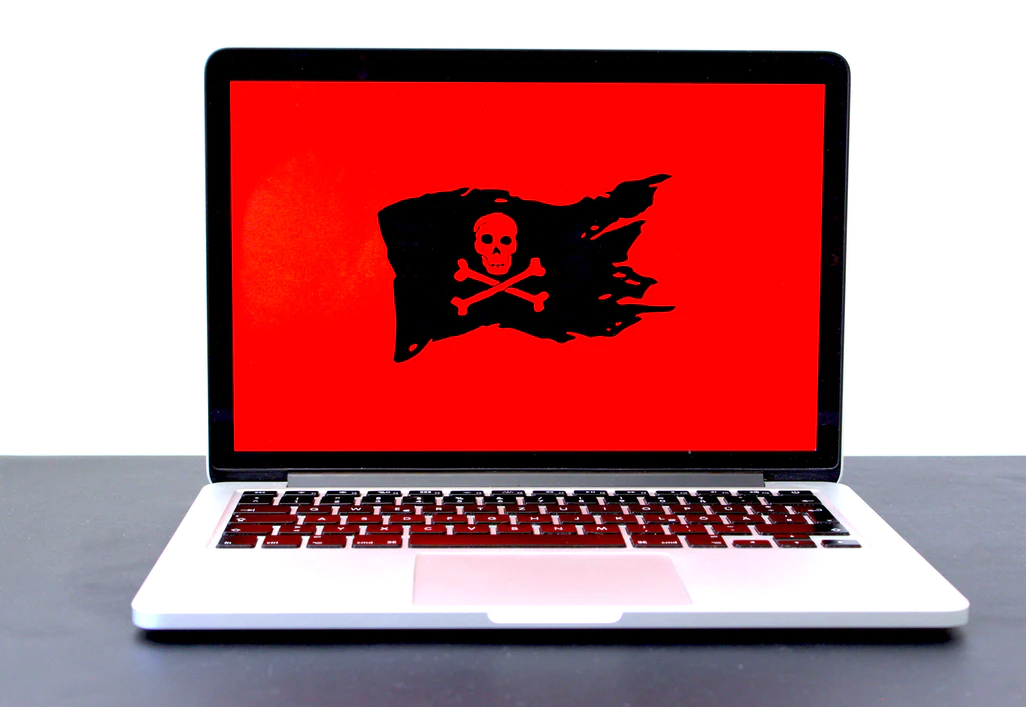 Laptop with a wallpaper bearing the Jolly Roger or the Pirate Flag